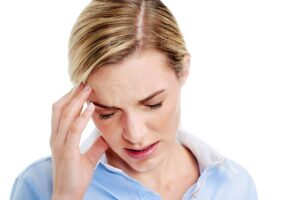 Young businesswoman has splitting headache pain migrain