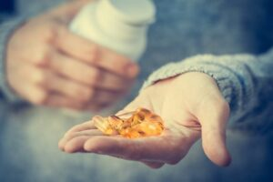 fish oil capsules in hand - omega 3 fatty acids