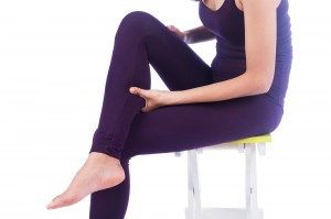 young women calf pain on white background